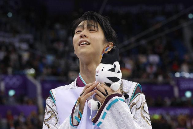 Figure Skating - Pyeongchang 2018 Winter Olympics - Men Single free skating competition final - Gangneung, South Korea - February 17, 2018 - Gold medallist Yuzuru Hanyu of Japan celebrates. REUTERS/Phil Noble